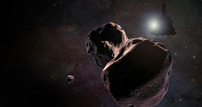 A handout photo by NASA shows an artist's impression of NASA's New Horizons spacecraft encountering 2014 MU69, nicknamed Ultima Thule, a Kuiper Belt object that orbits the Sun 1 billion miles (1.6 billion kilometers) beyond Pluto. (EPA Photo)