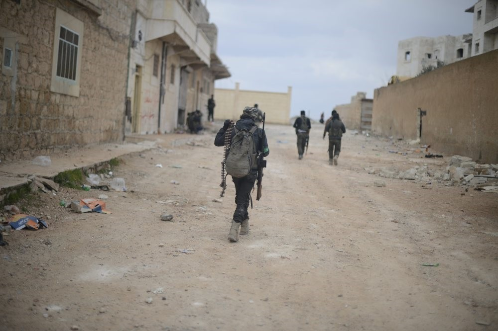 A Free Syrian Army fighter walking in the Syrian town of al-Bab after its liberation from Daesh terrorists as part of Operation Euphrates Shield launched by the Turkish military in support of FSA forces, Feb. 20.