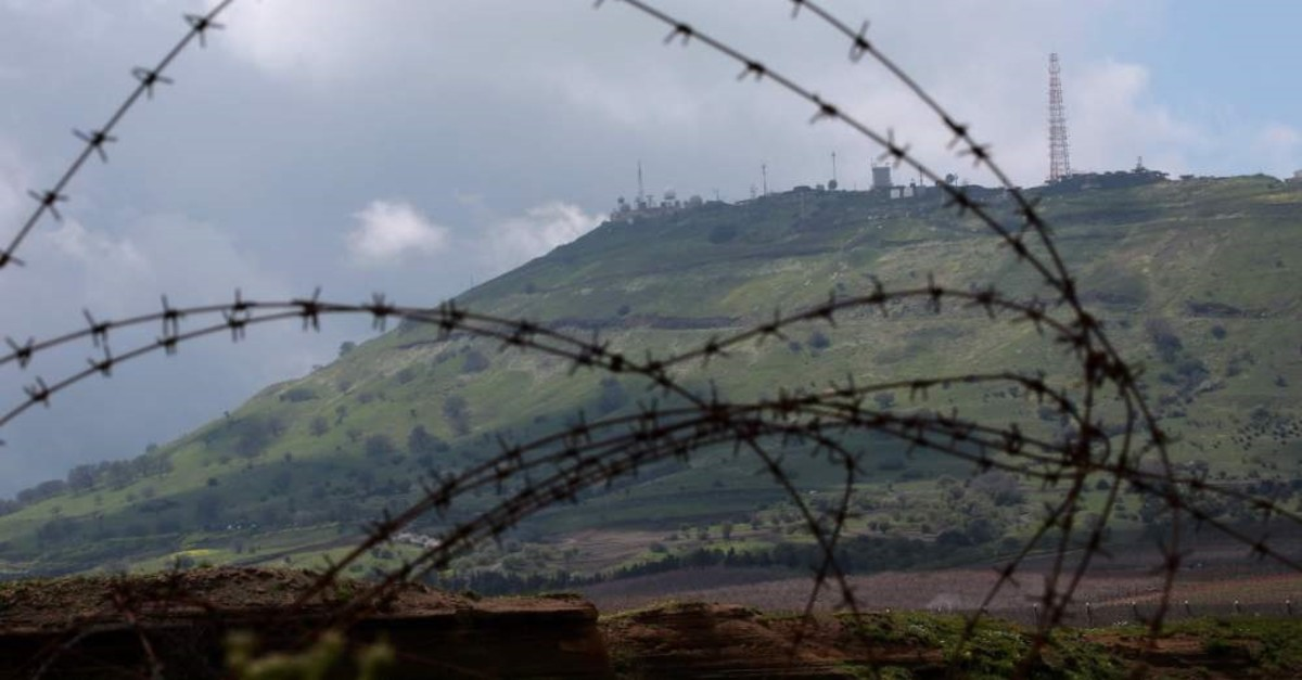 An Israeli military outpost in the Israeli-occupied Golan Heights as seen from the Syrian town of Quneitra, March 26, 2019.