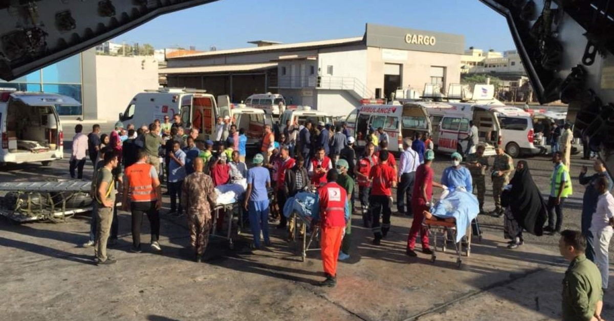 Turkish medical staff in the Somalian capital Mogadishu gather victims of a brutal terrorist attack that claimed nearly 80 people and wounded many others to transport them to Turkey for treatment, Dec. 28, 2019. (AA Photo)