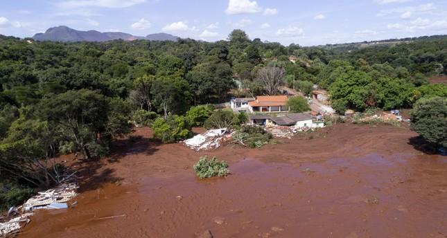 Flooding triggered by a collapsed dam near Brumadinho, Brazil (AP Photo)
