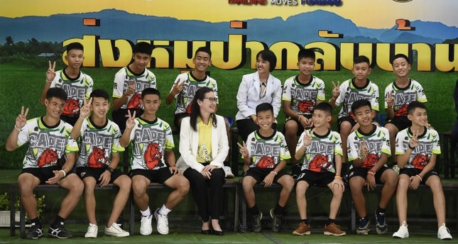 12 Thai boys and their football coach, rescued from a flooded cave after being trapped, attend a press conference in Chiang Rai on July 18, 2018, following their discharge from the hospital. (AFP Photo)