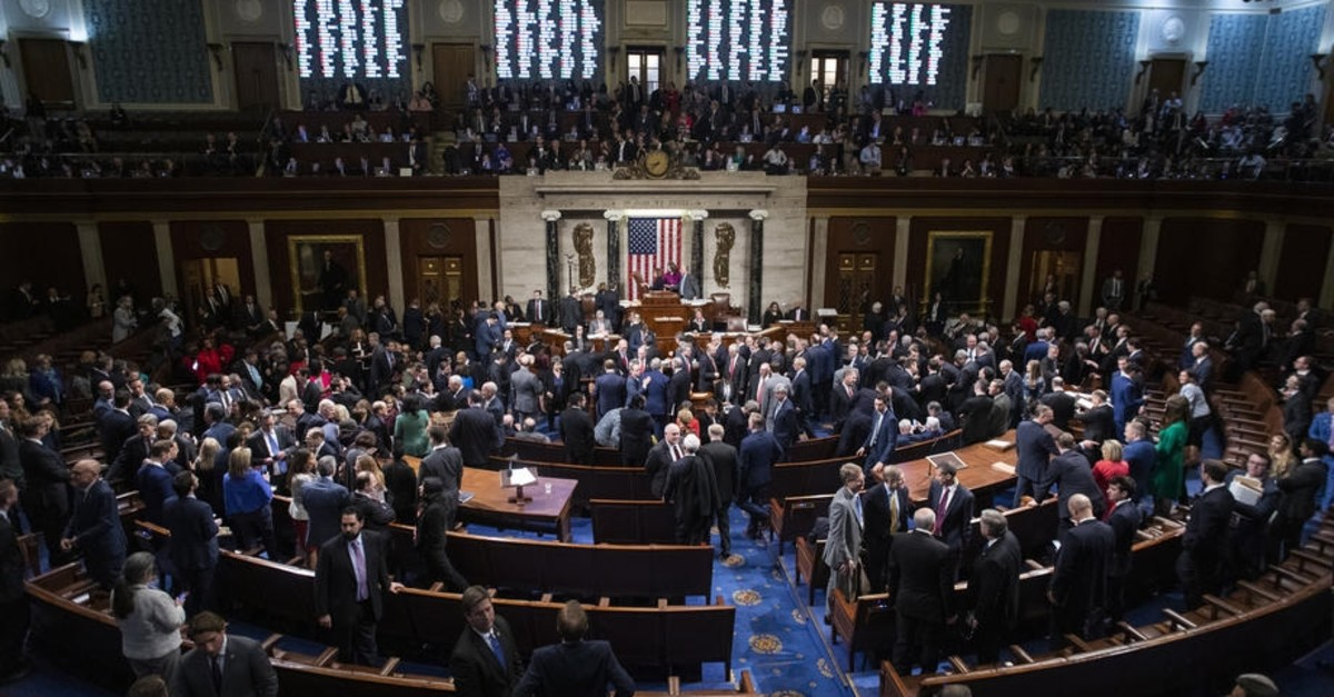 US Democratic Speaker of the House Nancy Pelosi presides over the votes to officially impeach US President Donald J. Trump (EPA Photo)