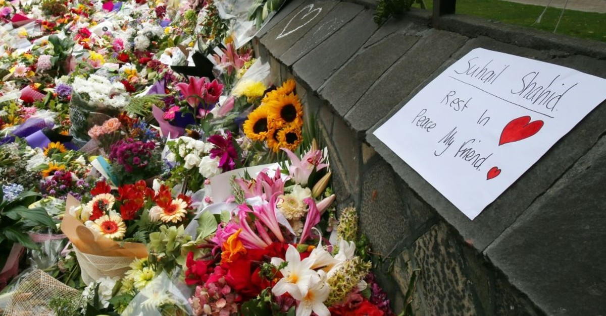 People pay tribute to the victims of the terrorist attacks against worshippers in Christchurch, New Zealand, March 19, 2019.