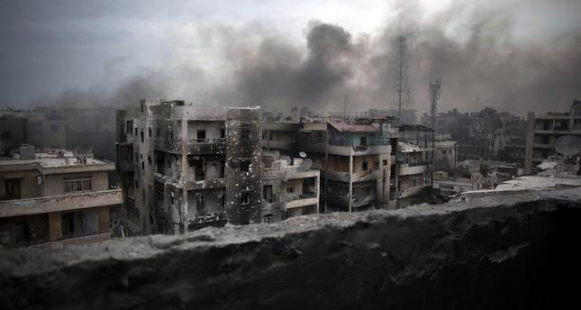 In this Oct. 2, 2012 file photo, smoke rises over Saif Al Dawla district, in Aleppo, Syria. (AP Photo)