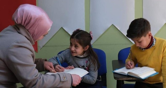 Berra Yunis with her children at the community center in Ankara. AA Photo