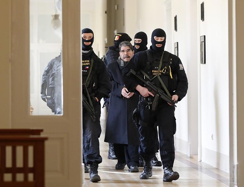 Policemen escort Salih Muslim, former co-chair of terrorist PKK-linked PYD, to a court room for a custody hearing in Prague, Czech Republic (AP Photo)