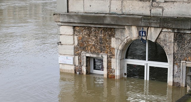 This photo taken Jan. 28, 2018 shows the cafe 'Les Nautes' in Paris partly immersed in the the water of the Seine river. (AFP Photo)