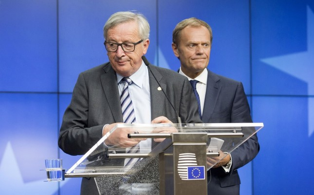 European Commission President Jean-Claude Juncker, left, and European Council President Donald Tusk prepare to leave after a final media conference at an EU summit in Brussels on June 29.