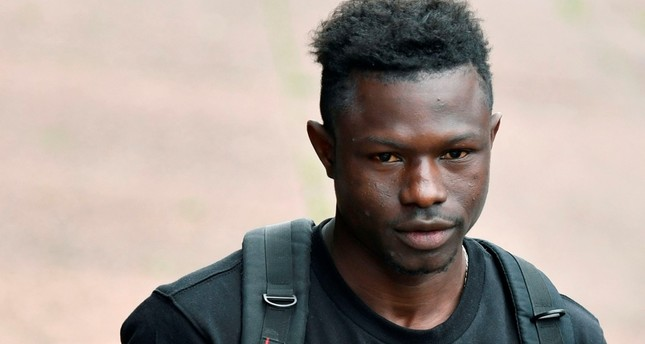 Malian migrant Mamoudou Gassama arrives to receive his temporary residence permit at the Prefecture of Bobigny, northeast of Paris on May 29, 2018. (AFP Photo)