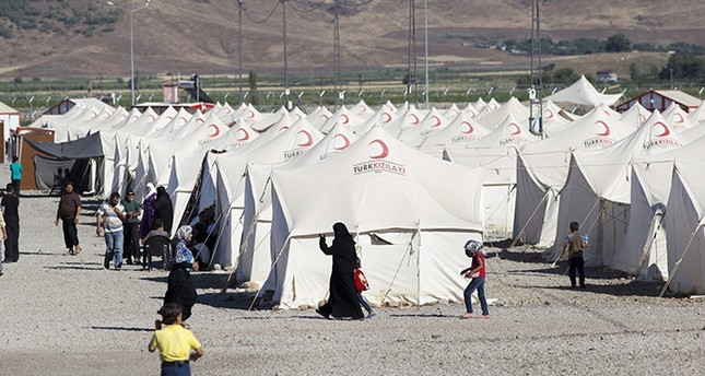 Syrian refugees at the Islahiye refugee camp in Hatay, Turkey 04 July 2012. One of eight refugee camps set up by Turkey and run by the Turkish Red Crescent to take refugees from the current conflict in Syria. (EPA Photo)