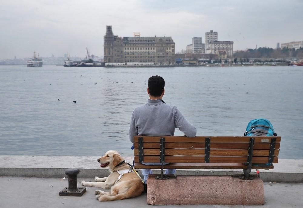 Aslan, accompanies Uu00e7ar during one of their trips along the Bosporus.