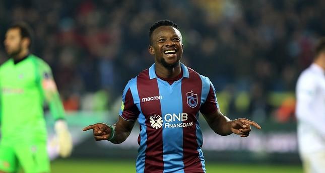 Trabzonspor's Nigerian international Ogenyi Onazi celebrates after scoring a goal.