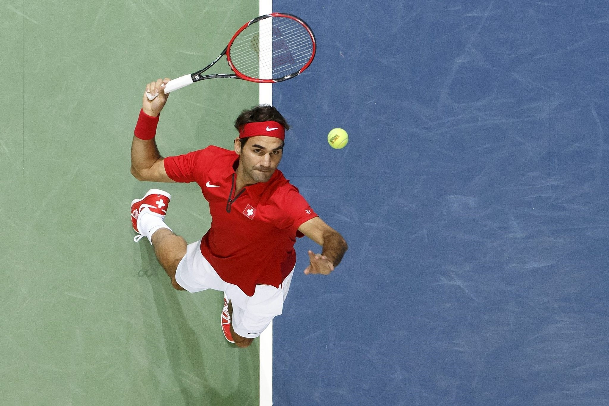 Roger Federer serves a ball to Thiemo De Bakker, of The Netherlands during the third single match of the Davis Cup. (AP Photo)