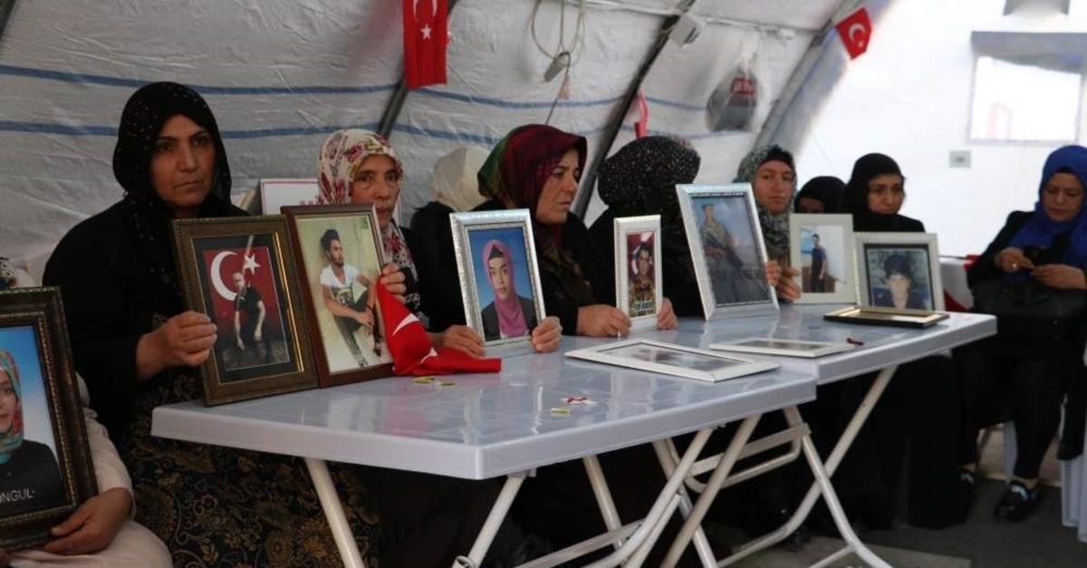 Kurdish mothers holding pictures of their children abducted by the PKK terrorist group during a sit-in protest in Diyarbak?r, Nov. 19, 2019.