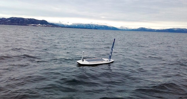 In this photo taken on March 14, 2018 and provided by Offshore Sensing, an autonomous Sailbuoy operated by Norwegian company Offshore Sensing performs a demonstration in the waters of Bjornafjorden, near Bergen, Norway. (AP Photo)