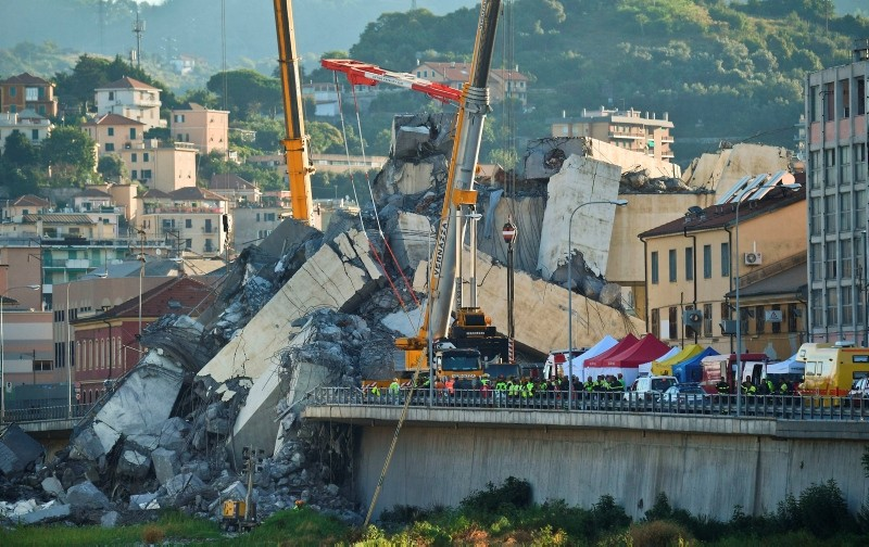 Rescuers search the crumbled hulk of the collapsed Morandi highway bridge in Genoa, northern Italy, Wednesday, Aug. 15, 2018. (AP Photo)