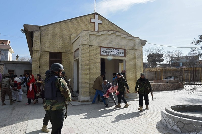 Pakistani security personnel rescue an injured woman after suicide bombers attacked a Methodist Church during a Sunday service in Quetta on Dec. 17, 2017. (AFP Photo)