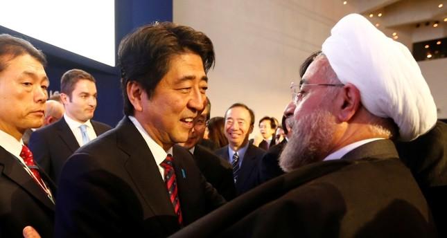 رئيس الوزراء الياباني شينزو آبي يلتقي الرئيس الإيراني حسن روحاني عام 2014 (من الأرشيف)