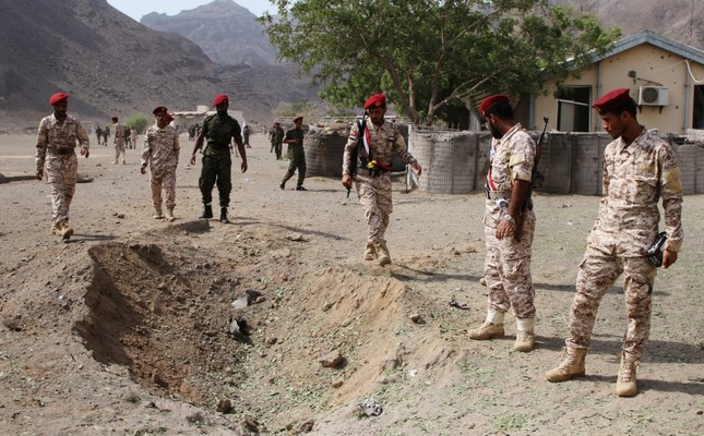 Soldiers are seen at the scene of the blast after a missile attack on a military parade during a graduation ceremony for newly recruited troopers in Aden, Yemen, Aug. 1, 2019. Reuters Photo