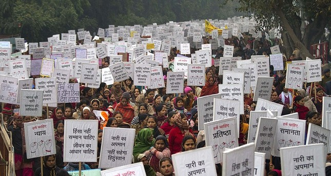 In this file photo, Indian women carry placards as they march to mourn the death of a gang rape victim in New Delhi, India, Wednesday, Jan. 2, 2013.  (AP Photo)