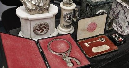 pIn a hidden room in a house near Argentina's capital, police believe they have found the biggest collection of Nazi artifacts in the country's history, including a bust relief of Adolf Hitler,...