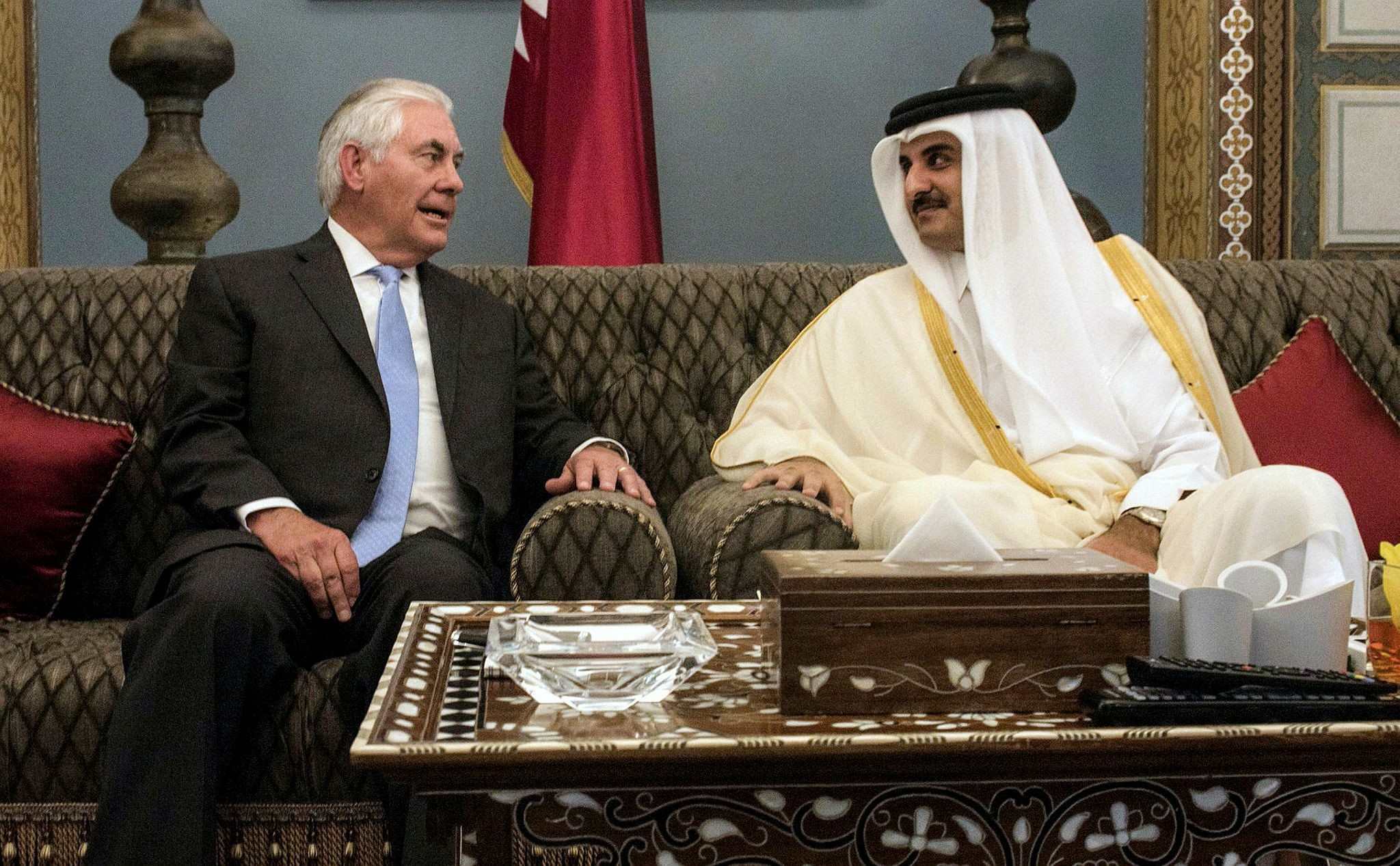 US Secretary of State Rex Tillerson (L) meeting with Qatar's Emir Sheikh Tamim bin Hamad Al-Thani on July 11, 2017 at the Prince's Sea Palace residence in the capital Doha (AFP PHOTO)