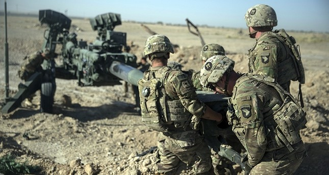 In this June 10, 2017 photo provided by Operation Resolute Support, U.S. Soldiers with Task Force Iron maneuver an M-777 howitzer, so it can be towed into position at Bost Airfield, Afghanistan. (AP Photo)