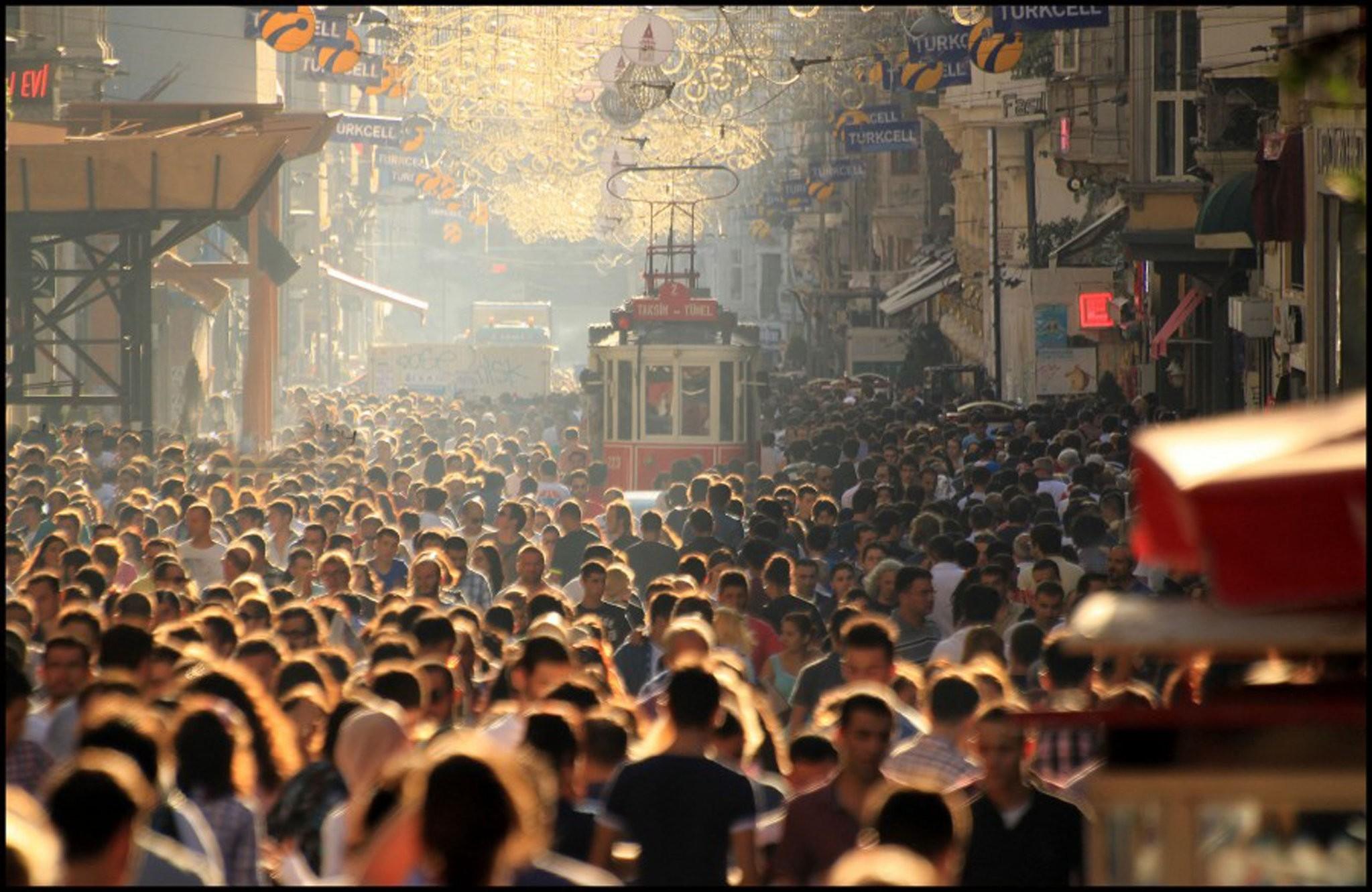 People walk on the u0130stiklal avenue in Istanbul.