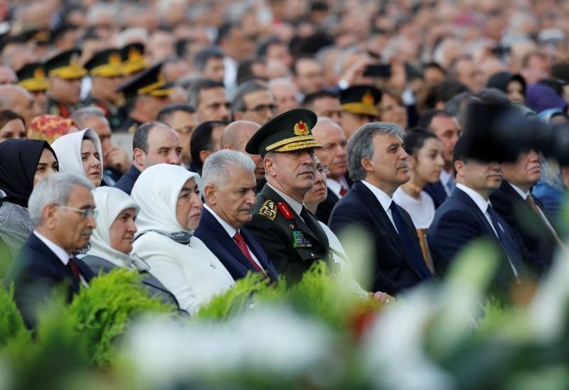 Former Prime Minister Binali Yıldırım, 4th left, Hulusi Akar, center, Chief of the General Staff, and Abdullah Gül, Turkey's former President, center right, attend a ceremony for President Recep Tayyip Erdoğan, in Ankara, Turkey, Monday, July 9, 2018.
