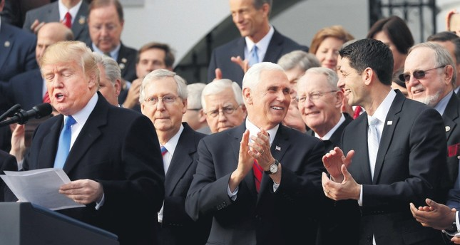 U.S. President Trump L celebrates with congressional Republicans after U.S. Congress passed sweeping tax overhaul legislation, Washington, Dec. 20 2017.