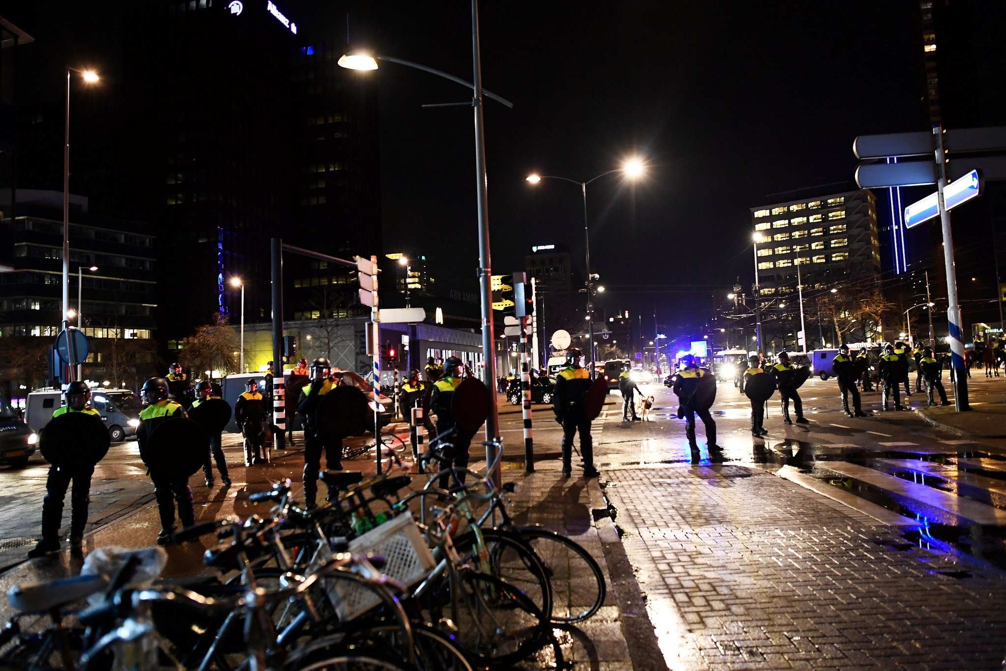 Dutch police standing on streets during clashes with demonstrators, who protested Dutch gov'tu2019s undemocratic decision to block Turkeyu2019s Minister of Family and Social Affairs, Fatma Betu00fcl Sayan Kaya to enter Turkish consulate in Rotterdam, March 11.