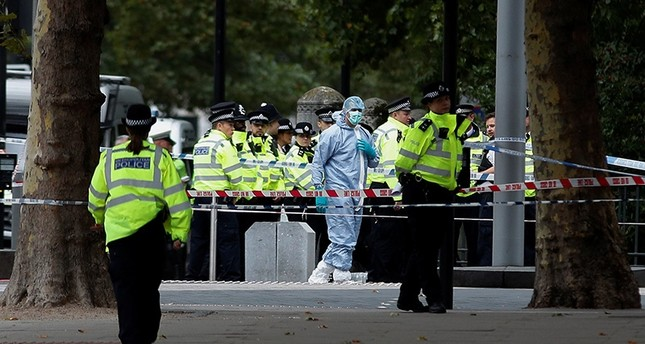 Police and forensic officers gather in the road near the Natural History Museum, after a car mounted the pavement, in London, Britain October 7, 2017 (Reuters Photo)