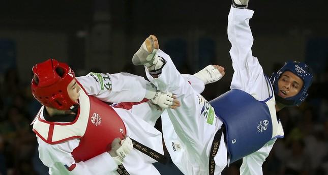 Servet Tazegül of Turkey competes with Ignacio Morales of Chile.