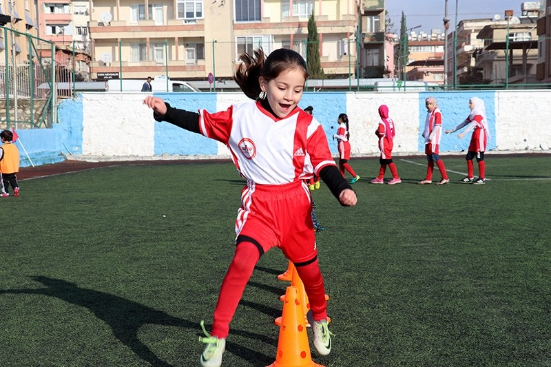 A young girl practices football through Turkish-Syrian program by SAR Foundation. (AA Photo)