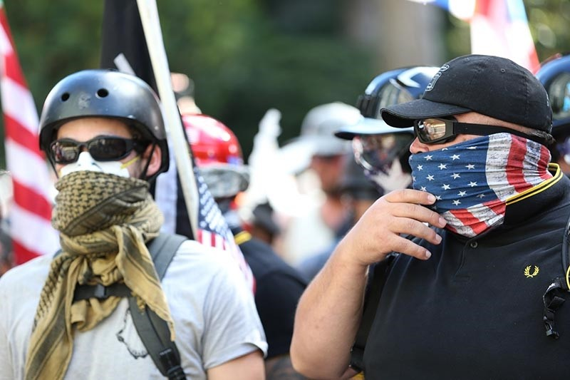 People demonstrate in a march by Patriot Prayer in Portland, Ore., on Saturday, June 30, 2018. Police dispersed clashing protesters as problems occurred when two opposing protest groups u2014 Patriot Prayer and antifa u2014 took to the streets. (AP Photo)