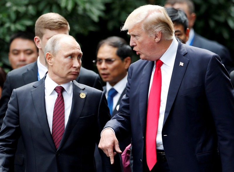 U.S. President Donald Trump and Russia's President Vladimir Putin talk during the family photo session at the APEC Summit in Danang, Vietnam November 11, 2017. (Reuters Photo)