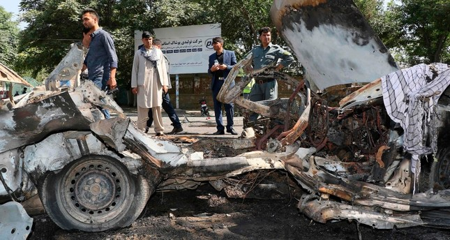 Afghans security personnel investigate at the site of a bomb explosion in front of Kanul University in Kabul on July 19, 2019. (AFP Photo)