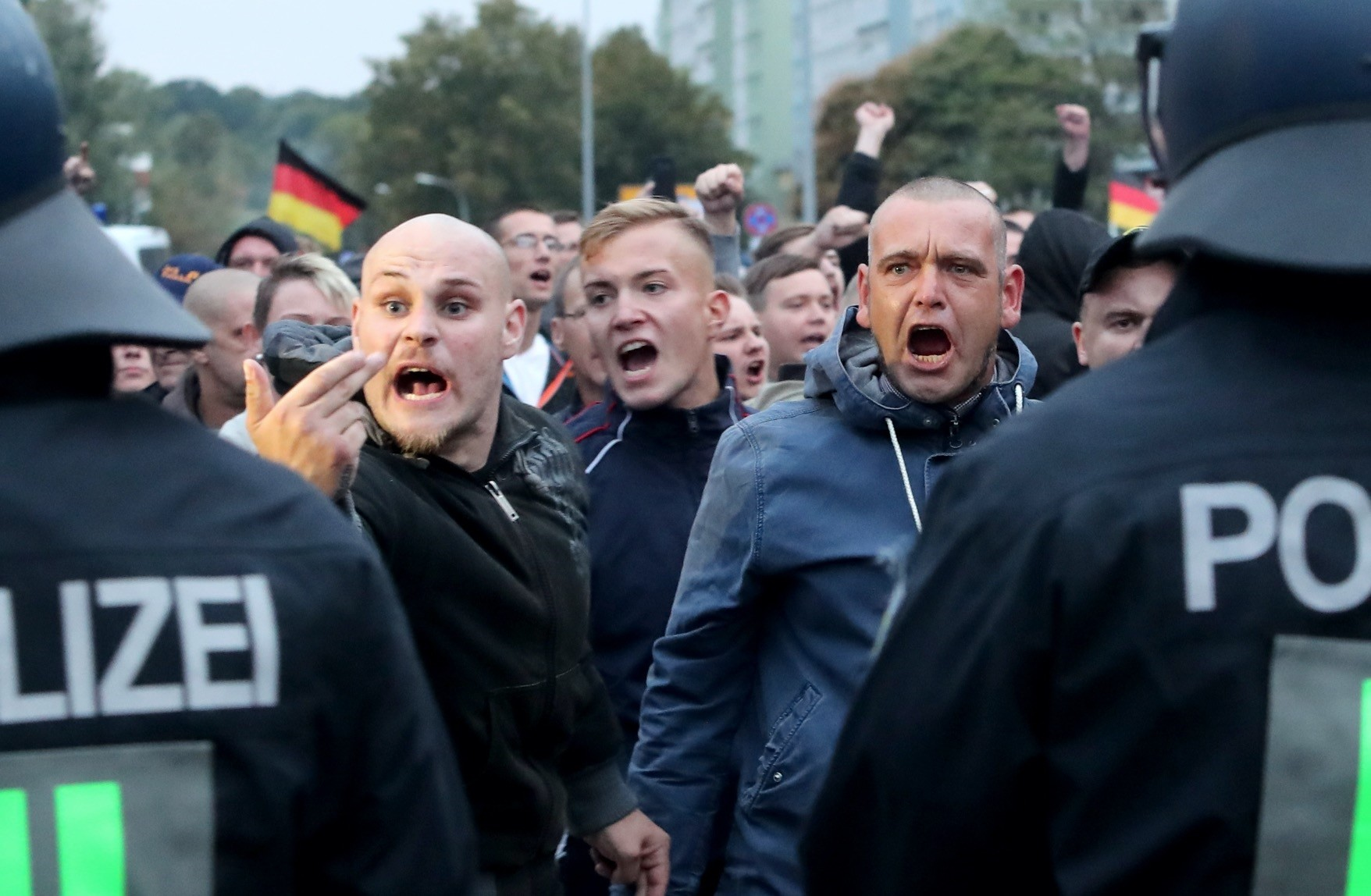 Right-wing protesters shout behind a row of police men, Chemnitz, Sept. 1.