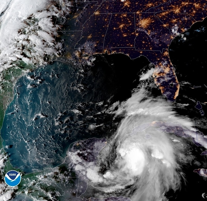 This satellite image provided by the National Oceanic and Atmospheric Administration shows a view of Tropical Storm Michael, lower right, churning as it heads toward the Florida Panhandle. (AP Photo)