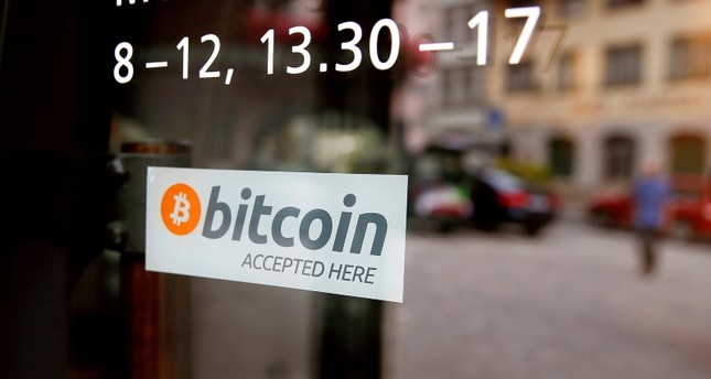 A sticker that reads Bitcoin accepted here is displayed at the entrance of the Stadthaus town hall in Zug, Switzerland, August 30, 2016. (Reuters Photo)