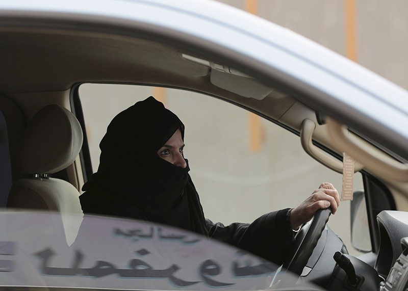 In this March 29, 2014 file photo, Aziza al-Yousef drives a car on a highway in Riyadh, Saudi Arabia, as part of a campaign to defy Saudi Arabia's ban on women driving. (AP Photo)
