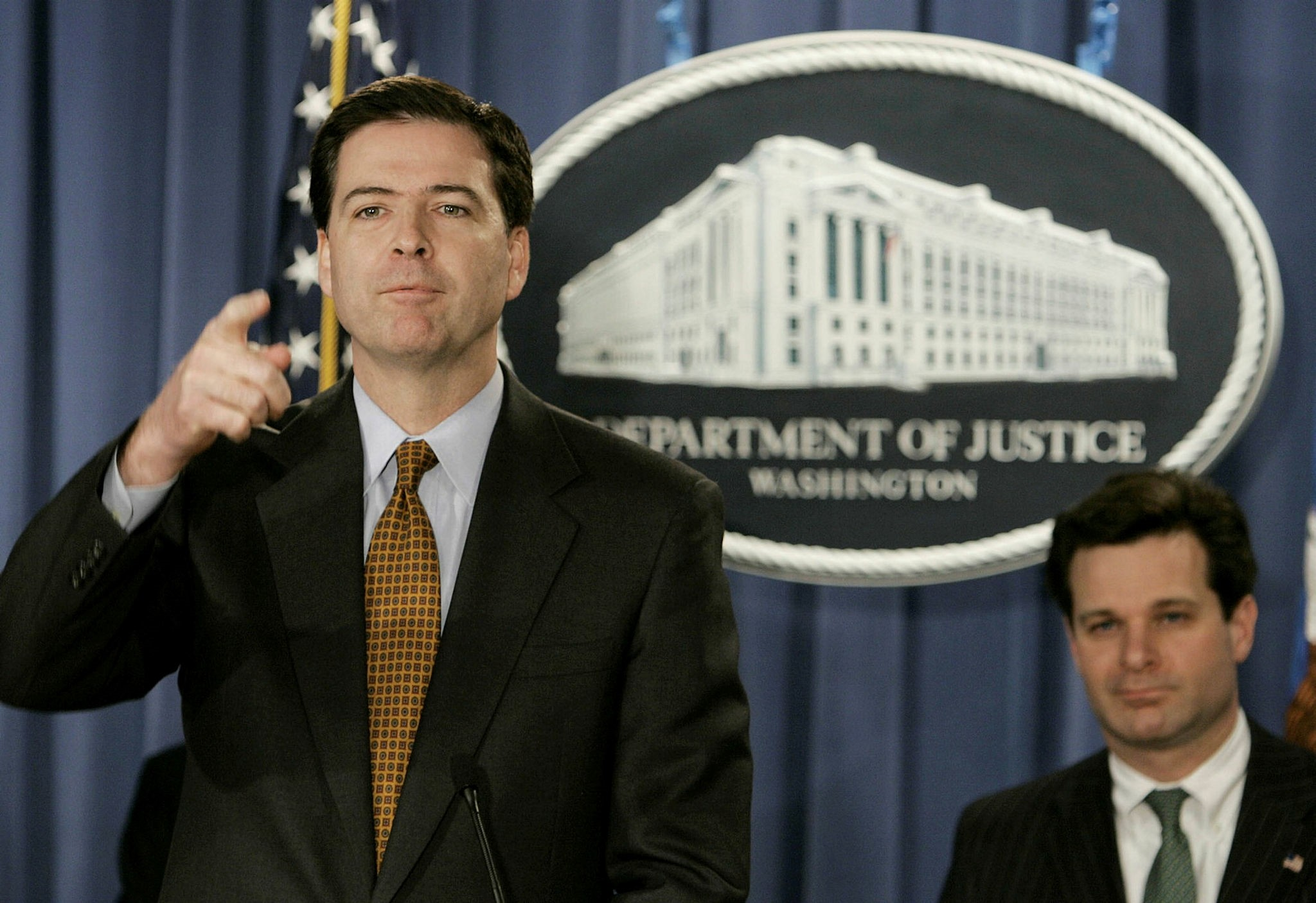 This file photo taken on December 15, 2004 shows Deputy US Attorney General James B. Comey (L) at a news conference with Assistant Attorney General Christopher Wray (R) at the Justice Department in Washington, DC. (AFP Photo)