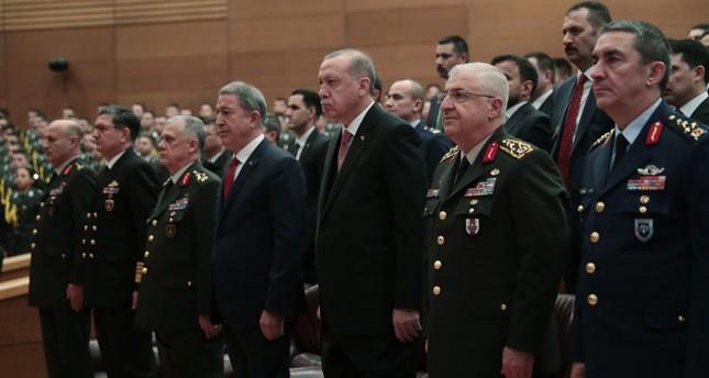 President Recep Tayyip Erdoğan C, flanked by Defense Minister Hulusi Akar 4L, Chief of Staff Gen. Yaşar Güler 2R, Army Commander Gen. Ümit Dündar 3L and Air Force Commander Gen. Hasan Küçükakyüz R, attends a ceremony in Ankara. AA Photo