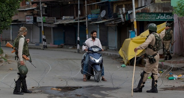 Indian paramilitary soldiers turn back a Kashmiri motorist near a temporary check point during lockdown in Srinagar, Indian controlled Kashmir, Sunday, Aug. 18, 2019. (AP Photo)