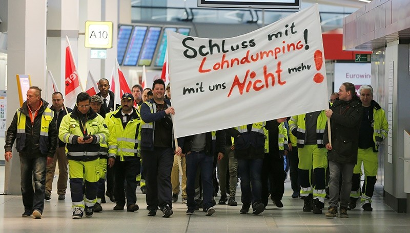 Members of Germany's Verdi union take part in a warning strike by ground services, security inspection and check-in staff at Tegel airport in Berlin, Germany March 10, 2017. (Reuters Photo)