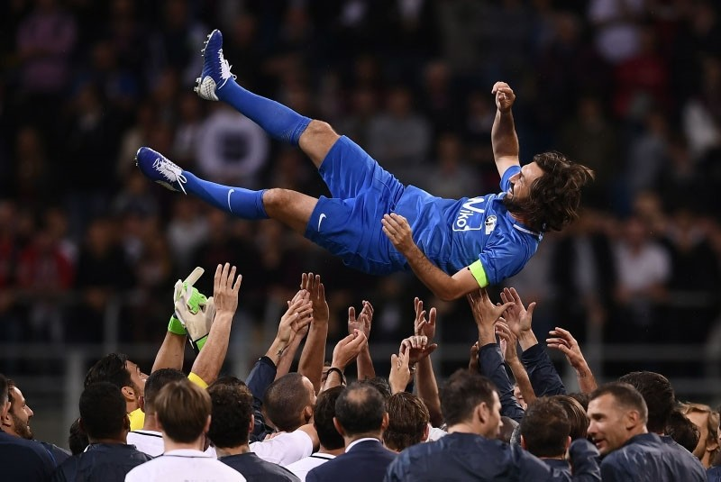 Former Italy's football player Andrea Pirlo celebrates with teammates at the end of the ,Notte del Maestro,, a football match celebrating the end of his career as a football player, on May 21, 2018 at the Giuseppe Meazza Stadium in Milan. (AFP Photo)