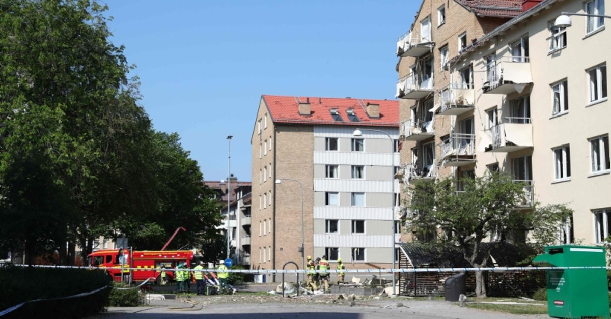 Rescue personnel work outside a block of flats that were hit by an explosion Friday morning, June 7, 2019 in Linkoping, southern Sweden. (Photo by Jeppe GUSTAFSSON / TT News Agency / AFP)