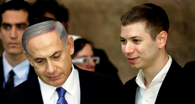 This file photo taken on March 18, 2015 shows Israeli Prime Minister Benjamin Netanyahu (L) and his son Yair visiting the Wailing Wall in Jerusalem. (AFP Photo)