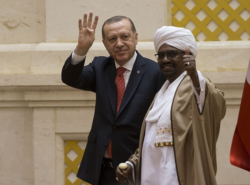 President Recep Tayyip Erdou011fan, left, stands next to his Sudanese counterpart Omar al-Bashir in Khartoum, Sudan, Dec. 24, 2017. (AA Photo)